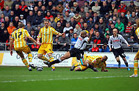 ATTENTION SPORTS PICTURE DESK<br /> Pictured: Darren Pratley of Swansea (in white) avoids a hard tackle by Fitz Hall of Newcastle  who is on the ground but faces opposition by Alan Smith (17)<br /> Re: Coca Cola Championship, Swansea City Football Club v Newcastle United at the Liberty Stadium, Swansea, south Wales. 13 February 2010