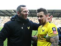 Michael Appleton manager of Oxford United congratulates Chris Maguire of Oxford United   during the Emirates FA Cup 3rd Round between Oxford United v Swansea     played at Kassam Stadium  on 10th January 2016 in Oxford