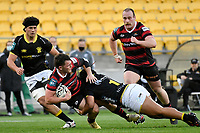 Dallas McLeod of Canterbury is tackled by Xavier Numia of Wellington during the Bunnings NPC - Wellington v Canterbury at Sky Stadium, Wellington, New Zealand on Friday 8 October 2021.<br /> Photo by Masanori Udagawa. <br /> www.photowellington.photoshelter.comto