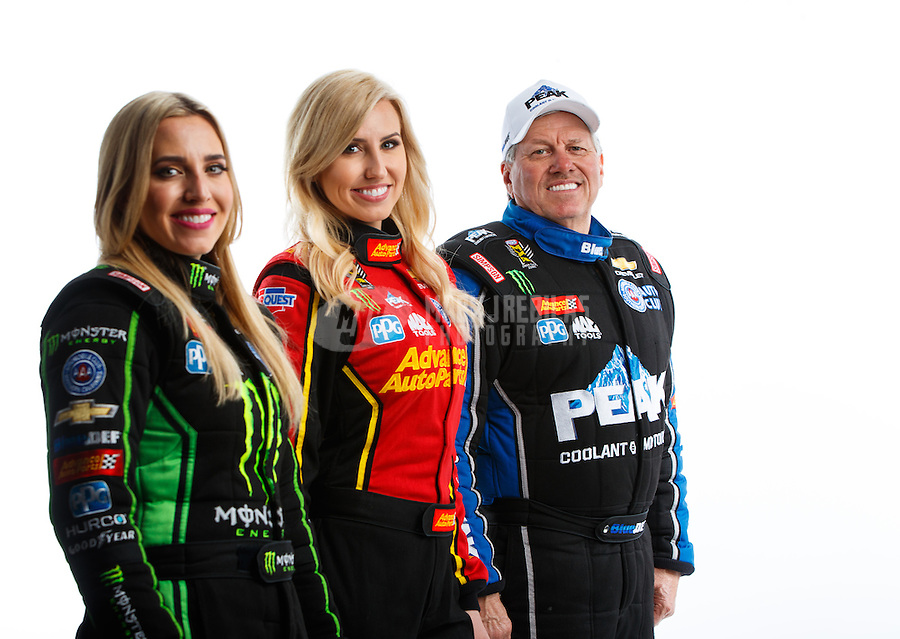 Feb 8, 2017; Pomona, CA, USA; NHRA funny car driver John Force (right), daughter Courtney Force (center) and top fuel driver Brittany Force pose for a portrait during media day at Auto Club Raceway at Pomona. Mandatory Credit: Mark J. Rebilas-USA TODAY Sports