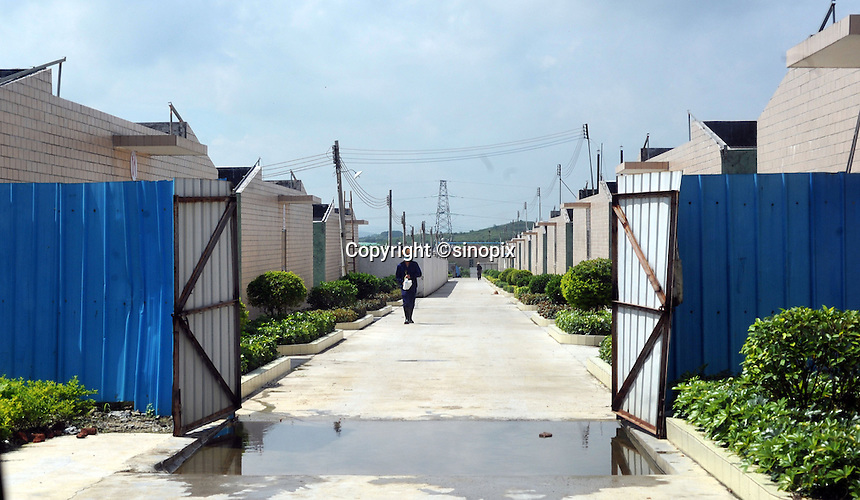 A worker at the new facility of the Guangzhou Blooming Spring Biological Technology Development Co, Ltd in Guangdong Province, China. The farm that is already in operation will be the biggest in the world holding 50,000 monkeys. The monkeys are bred solely for export to the US and Europe where pharmaceutical and cosmetic companies use them vivisection. ..SINOPIX PHOTO