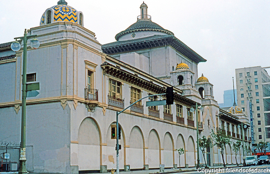 Mission Revival: Los Angeles Herald-Examiner Building, 1111 S. Broadway, 1912. Julia Morgan-Architect. Under the arches theme were windows displaying the great presses at work.  The tiled domes resemble that at the Santa Fe Depot in San Diego.