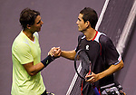 BANGKOK, THAILAND - OCTOBER 02:  Rafael Nadal (L) of Spain congratulates compatriot Guillermo Garcia-Lopez at the end of their match during the Day 8 of the PTT Thailand Open at Impact Arena on October 2, 2010 in Bangkok, Thailand. Photo by Victor Fraile / The Power of Sport Images