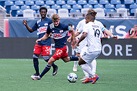 FOXBOROUGH, MA - JULY 4: Justin Rennicks #12 of the New England Revolution II moves to intercept a ball from Andrew Booth #19 of Greenville Triumph SC during a game between Greenville Triumph SC and New England Revolution II at Gillette Stadium on July 4, 2021 in Foxborough, Massachusetts.
