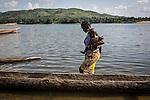 CAR, Bangui:  A woman walk into the Oubangui reiver after cleaning her baby. The river is often used by people of Bangui to clean themselves and to do their laundry. 20th April 2016<br /> <br /> RCA, Bangui : Une femme marche dans la rivière Oubangui après avoir lavé son bébé . La rivière est souvent utilisée par des personnes de Bangui pour se laver et faire leur lessive . 20 Avril 2016