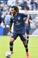 KANSAS CITY, KS - MAY 16: Gianluca Busio #10 Sporting KC with the ball during a game between Vancouver Whitecaps and Sporting Kansas City at Children's Mercy Park on May 16, 2021 in Kansas City, Kansas.