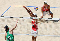 Campionati mondiali di beach volley, Roma, 18 giugno 2011..Germany's Julius Brink, left, spikes the ball against Poland's Grzegorz Fijalek, center,, and Mariusz Prudel, during the Beach Volleyball World Championship in Rome, 18 june 2011..UPDATE IMAGES PRESS/Riccardo De Luca