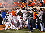 Oklahoma Sooners players taunt the Oklahoma State Cowboys before the game between the Oklahoma Sooners and the Oklahoma State Cowboys at the Boone Pickens Stadium in Stillwater, OK. Oklahoma State defeats Oklahoma 44 to 10..