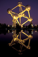 Brussels, Bruxelles, Belgium, Europe, Reflection of The Atomium, symbol of the 1958 World's Fair, a monument composed of nine giant metal spheres that represent the atoms of an iron molecule, in the water in the evening.