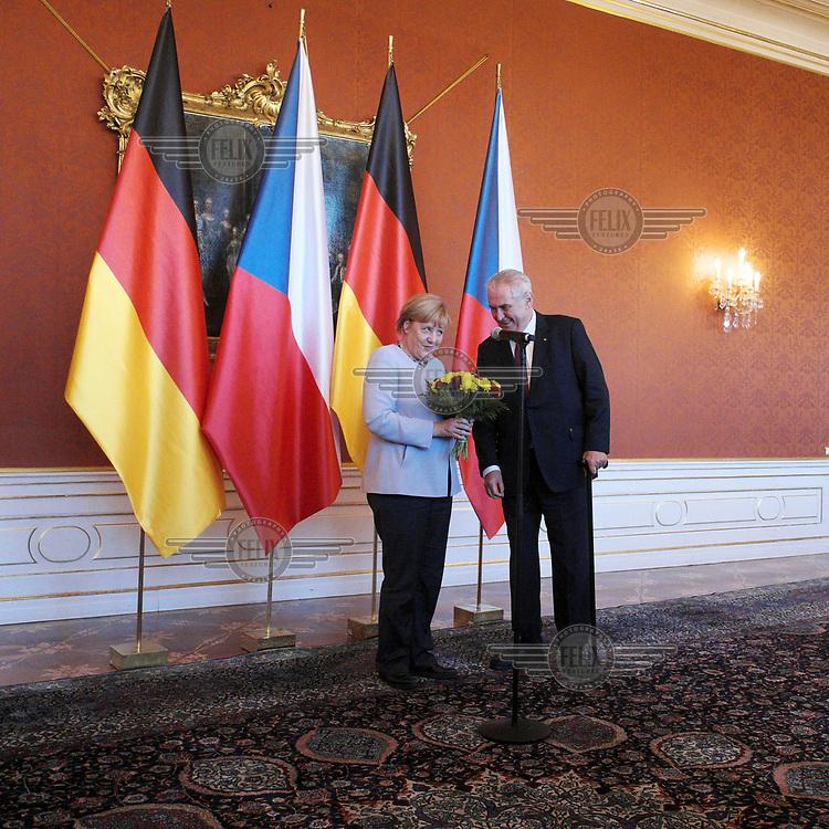 German Chancellor Angela Merkel meets with Czech President Milos Zeman at the Prague Castle.