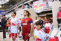 Juan Pablo Angel (9) of the New York Red Bulls and Kyle Beckerman (5) of Real Salt Lake lead their teams onto the field before the start of the game. The New York Red Bulls and Real Salt Lake played to a 0-0 tie during a Major League Soccer (MLS) match at Red Bull Arena in Harrison, NJ, on October 09, 2010.