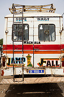 "Senegal, Touba.  ""Lamp Fall"" on a transport vehicle identifies the owner or driver as a follower of Sheikh Ibrahima Fall, one of the most influential disciples of the founder of the Mouride Islamic brotherhood, Ahmadu Bamba.  ""Lamp Fall"" is also the name of the tallest minaret of the Grand Mosque of Touba, where Ahmadu Bamba is buried.  ""Machala"" is Arabic for ""What God has willed"", often an expression of thanksgiving."