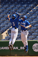 Memphis Tigers Ian Bibiloni (3) is greeted at home by Hunter Goodman (35) after hitting a home run during a game against the East Carolina Pirates on May 25, 2021 at BayCare Ballpark in Clearwater, Florida.  Memphis defeated ECU 11-1 in the opening game of the American Athletic Conference Tournament.  (Mike Janes/Four Seam Images)