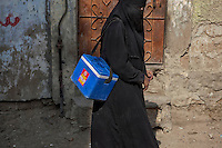 A Pakistani lady health worker during 'Anti-polio campaign' in Karachi, Pakistan on Jan. 19, 2015