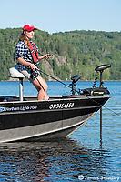 Female angler trolling open water