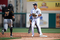 Detroit Tigers first baseman Daniel Pinero (34) waits for a throw as Sammy Siani (28) runs up the base line during a Florida Instructional League game against the Pittsburgh Pirates on October 16, 2020 at Joker Marchant Stadium in Lakeland, Florida.  (Mike Janes/Four Seam Images)