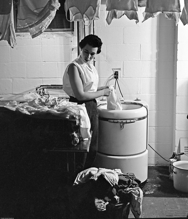 Client: Eiben and Irr Department Store<br /> Ad Agency: None / Eiber and Irr<br /> Product: Maytag Washing Machine<br /> Location: Brady Stewart Jr.'s house; 2668 Summit Street, Bethel Park PA.<br /> <br /> Model, Marjorie Stewart is washing clothes in the new Kenmore washing machine from Eiben and Irr.
