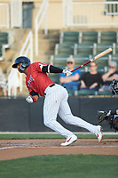 Amado Nunez (18) of the Piedmont Boll Weevils follows through on his swing against the Hickory Crawdads at Kannapolis Intimidators Stadium on May 3, 2019 in Kannapolis, North Carolina. The Boll Weevils defeated the Crawdads 4-3. (Brian Westerholt/Four Seam Images)