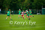 A tussle for possession between Patrice Diggin of Kerry and  Aoife Shaw of Derry in the Intermediate Camogie championship