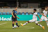 SAN JOSE, CA - SEPTEMBER 16: Eryk Williamson #30 of the Portland Timbers & Oswaldo Alanis #4 of the San Jose Earthquakes battle for the ball during a game between Portland Timbers and San Jose Earthquakes at Earthquakes Stadium on September 16, 2020 in San Jose, California.