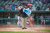 Field crew members repair the batter's box as the rain begins to fall during a Midwest League game between the Kane County Cougars and Fort Wayne TinCaps at Parkview Field on May 1, 2019 in Fort Wayne, Indiana. Fort Wayne defeated Kane County 10-4. (Zachary Lucy/Four Seam Images)