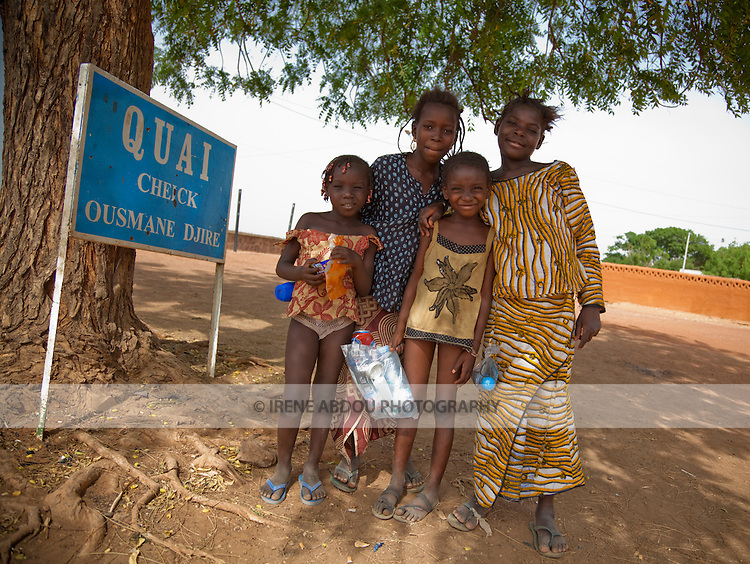 A group of children pose for a photo at the Cheick Ousmane Djire docks in Segou, Mali.