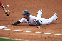 Rochester Red Wings designated hitter Wilkin Ramirez (7) slides into third during a game against the Buffalo Bisons on July 8, 2015 at Frontier Field in Rochester, New York.  Rochester defeated Buffalo 6-5.  (Mike Janes/Four Seam Images)