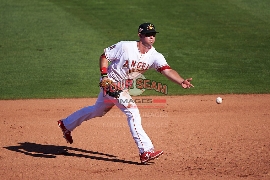 Mesa Solar Sox first baseman Eric Aguilera (24) flips the ball to first during an Arizona Fall League game against the Glendale Desert Dogs on October 14, 2015 at Sloan Park in Mesa, Arizona.  Glendale defeated Mesa 7-6.  (Mike Janes/Four Seam Images)
