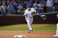 Chicago Cubs shortstop Addison Russell (27) flips the ball to second base in the second inning during Game 3 of the Major League Baseball World Series against the Cleveland Indians on October 28, 2016 at Wrigley Field in Chicago, Illinois.  (Mike Janes/Four Seam Images)