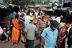 Over crowded market place in Kolkata during the 21 days lockdown in India. Indian people buy vegetables at Muchi bazzar in Kolkata. India is going through a 21 days lock down for Corona virus pandemic. As the government gave relaxation to lockdown in the morning to shop for daily needs hence neither the social distancing is maitained nor people are using protective masks and gloves, now the authorities are concerned about the spread of the disease. Kolkata, West Bengal, India. Arindam Mukherjee.