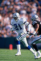 OAKLAND, CA - Deion Sanders of the Dallas Cowboys in action during a game against the Oakland Raiders at the Oakland Coliseum in Oakland, California on November 19, 1995. (Photo by Brad Mangin)