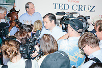 Supporters and reporters surround Texas senator and Republican presidential candidate Ted Cruz after he spoke to a crowd at the kick-off event at his New Hampshire campaign headquarters in Manchester, New Hampshire.