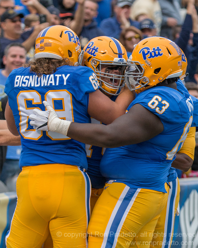 Pitt offensive lineman Brian O'Neill celebrates is 24-yard touchdown run off of a backwards pass. The Pitt Panthers defeated the Georgia Tech Yellow Jackets 37-34 at Heinz Field in Pittsburgh, Pennsylvania on October 08, 2016.
