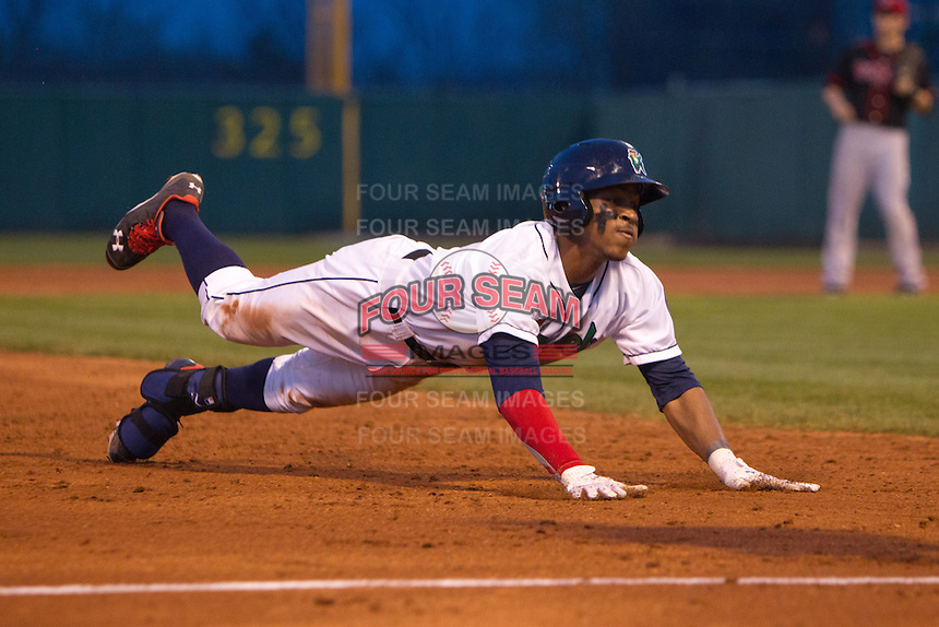 Cedar Rapids Kernels outfielder Byron Buxton #7 slides into third base during a game against the Lansing Lugnuts at Veterans Memorial Stadium on April 29, 2013 in Cedar Rapids, Iowa. (Brace Hemmelgarn/Four Seam Images)