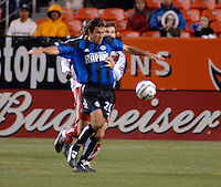 Colorado forward Jovan Kirovski shields the ball from FC Dallas defender Greg Vanney. The Colorado Rapids drew 0-0 with FC Dallas in the first game of the Western Conference Semi-finals Invesco Field at Mile High, Denver, Colorado, September 22, 2005.