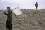 Game bird shoot pheasant shooting  private estate Lancashire England. Boy acting as a beater. 1980s UK<br /> Gerry Grimstone, 1980s Lord Grimstone of Boscobel, won embankment.