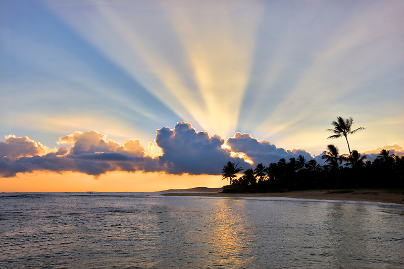 Sunset at Poipu Beach with rays of light. Kauai, Hawaii