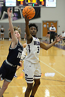 Fayetteville's Landon Glasper (3) pulls down a rebound Tuesday, Jan. 5, 2021, in front of Bentonville West's Cade Packnett (10) during the first half of play in Bulldog Arena in Fayetteville. Visit nwaonline.com/210106Daily/ for today's photo gallery. <br /> (NWA Democrat-Gazette/Andy Shupe)