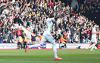 Swansea City fans celebrate as Modou Barrow of Swansea City celebrates scoring during the Barclays Premier League match between AFC Bournemouth and Swansea City played at The Vitality Stadium, Bournemouth on March 11th 2016