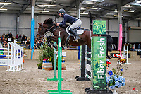 NZL-Keean Cooper rides Pythia. Class 30: Sky Sport Next 1.30m-1.35m 10K - FINAL. 2021 NZL-Easter Jumping Festival presented by McIntosh Global Equestrian and Equestrian Entries. NEC Taupo. Sunday 4 April. Copyright Photo: Libby Law Photography