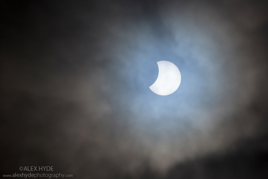 Partial cloud cover added drama to the solar eclipse in the Peak District, Derbyshire, UK. 20-03-2015.