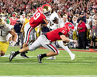 ATHENS, GA - SEPTEMBER 21: Jake Fromm #11 of the Georgia Bulldogs carries the ball for a gain against the Notre Dame Fighting Irish during a game between Notre Dame Fighting Irish and University of Georgia Bulldogs at Sanford Stadium on September 21, 2019 in Athens, Georgia.
