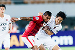 Guangzhou Midfielder Paulinho Maciel (L) fights for the ball with Kashima Midfielder Mu Kanazaki (R) during the AFC Champions League 2017 Round of 16 match between Guangzhou Evergrande FC (CHN) vs Kashima Antlers (JPN) at the Tianhe Stadium on 23 May 2017 in Guangzhou, China. (Photo by Power Sport Images/Getty Images)