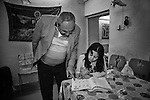 25..3.2015 Kirkuk,Iraq. Marta doing her homework with her father in the evening.