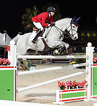 Laura Kraut and Cedric compete for the United States of America in the $75,000 FEI Nations Cup, an Olympics-style show jumping event, on Friday night, Feb. 28, 2009, during the Winter Equestrian festival in Wellington, Fla. Canada won the eight-nation, two-round competition before the first sellout (8,000) at the recently-renovated Palm Beach International Equestrian Center. Canada edged Ireland and Great Britain (tie) for the blue ribbons, followed by the United States. Also competing were teams from Argentina, France, Mexico and Venezuela. Thousands of cheering, flag-waving fans packed the International Arena at the WEF grounds for the Nations Cup, reportedly the oldest and most prestigious team show jumping competition in the world. Photo by Bob Markey II