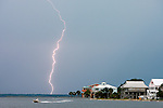 A fisherman rushes home after a lightning strike from an ominous storm at Shell Point along the Forgotten Coast in the Florida panhandle south of Tallahassee, Florida.    (Mark Wallheiser/TallahasseeStock.com)
