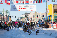 Roger Lee and team leave the ceremonial start line with an Iditarider and handler at 4th Avenue and D street in downtown Anchorage, Alaska on Saturday March 4th during the 2017 Iditarod race. Photo © 2017 by Brendan Smith/SchultzPhoto.com.