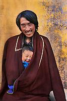 Amdo, Tibet 2005. Man and child in Tongen, Amdo, Eastern Tibet, 2005