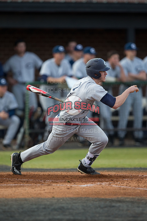 Luke Setzer (4) of the Catawba Indians follows through on his swing against the Belmont Abbey Crusaders at Abbey Yard on February 7, 2017 in Belmont, North Carolina.  The Crusaders defeated the Indians 12-9.  (Brian Westerholt/Four Seam Images)