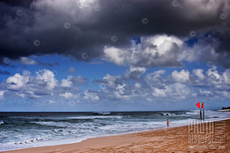 Beautiful seascape with dangerous surf under cloudy skies onNorth Shore of Oahu.